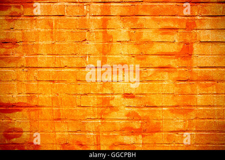 brick wall in orange colors as a background - Stock Photo