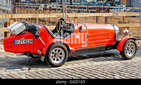 Dusseldorf, Germany - May 3, 2013: Old red car in the streets in the Old city center of Dusseldorf in Germany. It is the capital of Rhine Westphalia region. Stock Photo