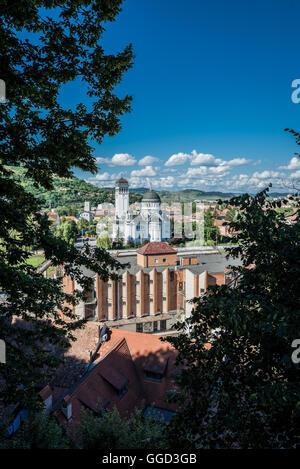 Romanian Orthodox Holy Trinity Church - view from hill of Historic Centre of Sighisoara city, Transylvania region - Stock Photo