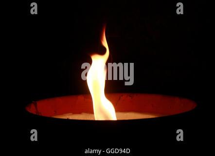 feuer fire night darkness candle light atmosphere grief mounring symbol symbolic gedenken feuerschale - Stock Photo