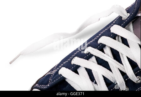 Closeup lacing on athletic shoes isolated on white background - Stock Photo