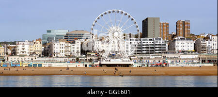 Brighton's Big Wheel captured from the Victorian pier on the South Coast of the UK - Stock Photo