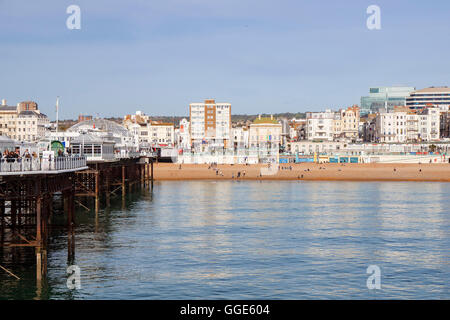 Brighton's iconic Victorian pier on the South Coast of the UK - Stock Photo