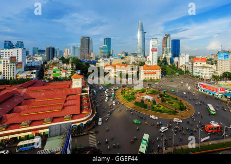 Impression, colorful, vibrant scene of Asia traffic, dynamic, crowded city with trail on street, Saigon, Vietnam - Stock Photo
