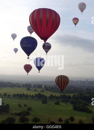 Balloons ascend in to the sky on the press launch for the 2016 Bristol Balloon Fiesta at Ashton Court Estate, Bristol. - Stock Photo