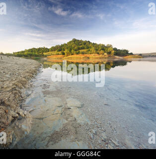 Lake and spring green hills. Composition of nature - Stock Photo