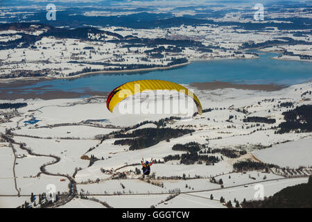 geography / travel, Germany, Bavaria, panorama from the Tegelberg Massif, paraglider, behind Lake Forggen (Forggensee), - Stock Photo