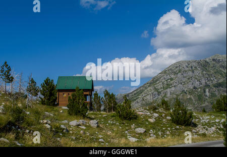 Lonely house on hill - Stock Photo