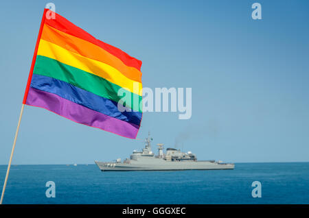 A gay flag and navy ship in the background with copy space - Stock Photo