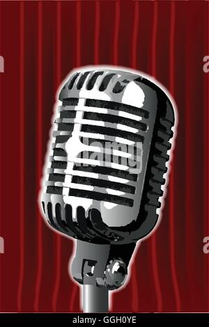 A microphone ready on stage against a red curtain. - Stock Photo