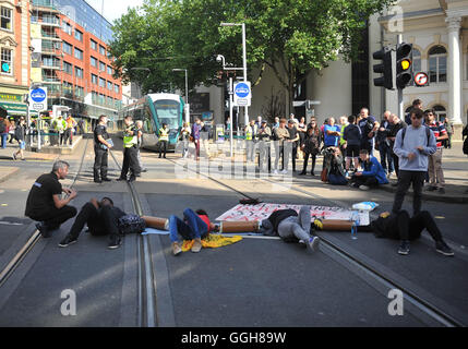 Activists outside Nottingham Theatre Royal shut down part of the city centre tram and bus network to protest for - Stock Photo