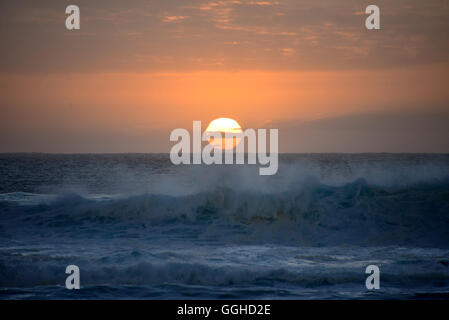 Waves in sunset, El Cotillo, Fuerteventura, Canary Islands, Spain - Stock Photo