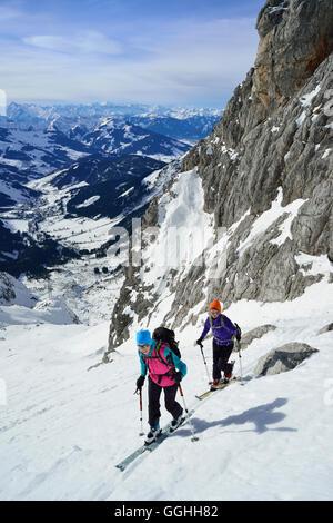 Two female back-country skiers ascending to Marterlkopf, Steinernes Meer, Berchtesgaden Alps, Salzburg, Austria - Stock Photo