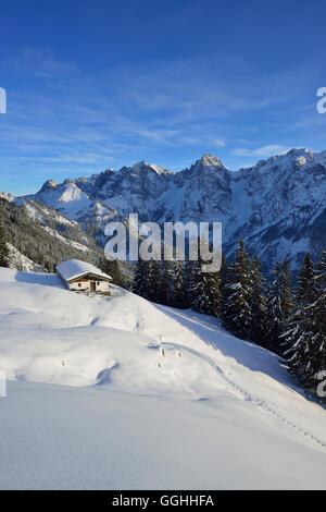 Snow-covered alpine hut in front of mountain scenery, Wilder Kaiser, Kaiser Mountains, Tyrol, Austria - Stock Photo