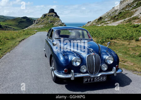 Jaguar Oldtimer on its way from Valley of the Rocks near Lynton, Devon, England, Great Britain - Stock Photo