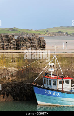 Lobster cages, fishing boat and quay, Harbour, Padstow, Cornwall, England, Great Britain - Stock Photo