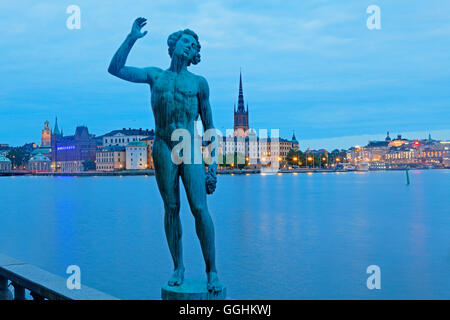 Bronze Statue Sangen in city hall garden and Riddarholmen with Riddarholmen church in the background, Stockholm, - Stock Photo