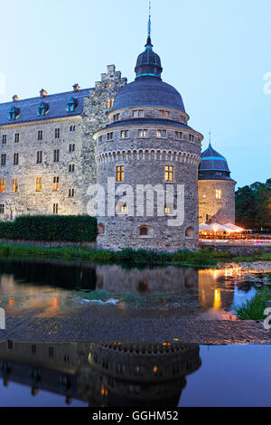 Moated castle in the evening, Oerebro slott, Oerebro, Sweden - Stock Photo