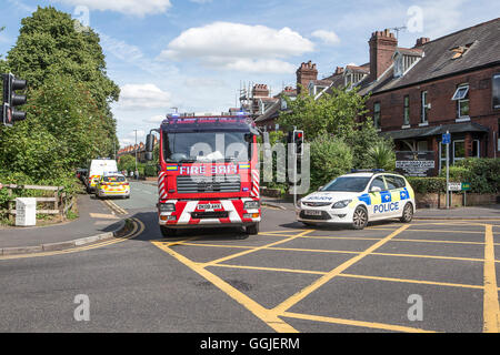 Police car and fire engine block a road in Stockton Heath, Cheshire, Uk - Stock Photo