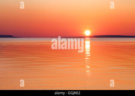 A Great Lakes Sunrise Over The Straits Of Mackinac At Old Mackinac Point, Michigan, USA - Stock Photo