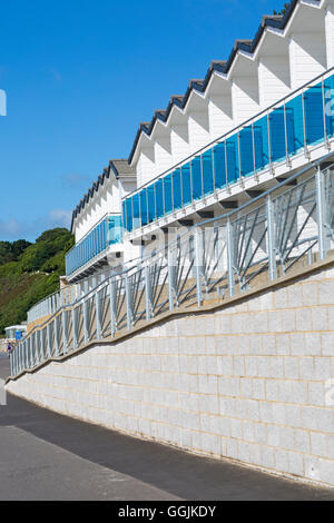 Beach huts between Branksome Dene and Branksome Chine, Poole, Dorset, UK in July - Stock Photo
