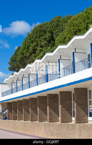 beach huts at Branksome Dene Chine, Poole in July - Stock Photo