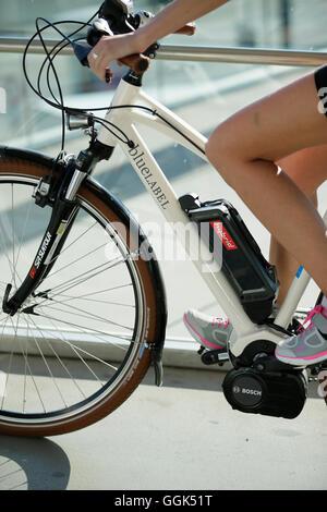 Woman riding an e-bike, Munsing, Upper Bavaria, Germany - Stock Photo