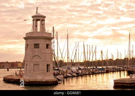 Small lighthouse at the entrance to the marina on Isola di San Giorgo Maggiore island along Bacino di San Marco - Stock Photo