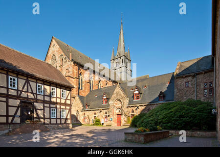 Courtyard in front of the daycare center of the forensic clinic with the historic buildings of Haina monastery, - Stock Photo