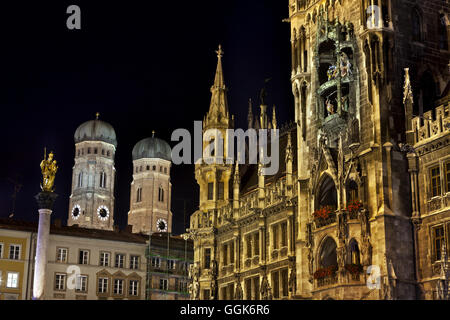 Munich Town Hall and the towers of the Frauenkirche at night, Munich, Bavaria, Germany - Stock Photo
