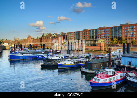 Ships in inland port with old and modern buildings of the old Warehouse district, Warehouse district, Speicherstadt, - Stock Photo