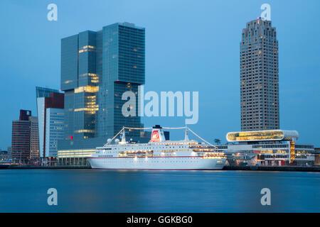 Cruise ship MS Deutschland (Reederei Peter Deilmann) at Rotterdam Cruise Terminal on Nieuwe Maas river with high - Stock Photo