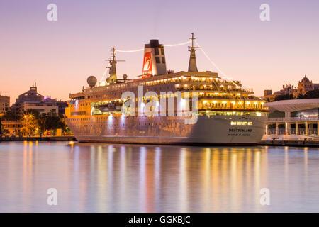 Cruise ship MS Deutschland (Reederei Peter Deilmann) at Malaga Cruise Terminal at dusk, Malaga, Andalusia, Spain - Stock Photo