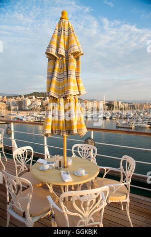Sunshade and tables of the Lido Cafe aboard cruise ship MS Deutschland (Reederei Peter Deilmann), Palma, Mallorca, - Stock Photo