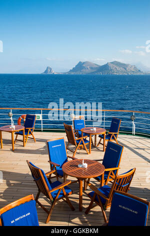 Tables and chairs outside bar Zum Alten Fritz aboard cruise ship MS Deutschland (Reederei Peter Deilmann), near - Stock Photo