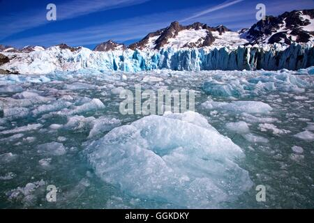chunks of ice falling in front of the Knud Rasmussen Glacier, East Greenland, Greenland - Stock Photo