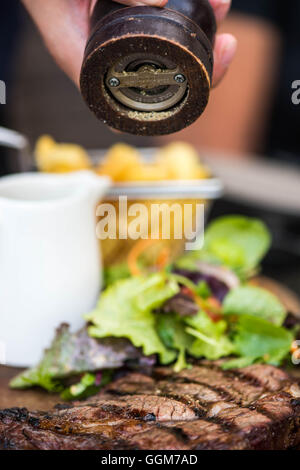 Succulent Grilled Fresh Fillet Of Ribeye Beef Steak Served With A Green Leaf Salad With No People - Stock Photo