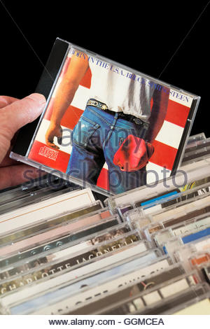 Born In The USA CD by Bruce Springsteen being chosen from among rows of other CD's - Stock Photo