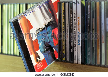 Born In The USA CD by Bruce Springsteen pulled out from among other CD's on a shelf - Stock Photo