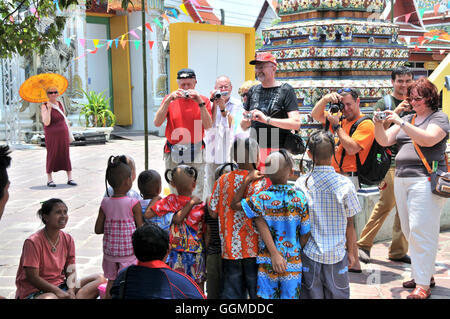 Tourists in Wat Po, Bangkok, Thailand - Stock Photo