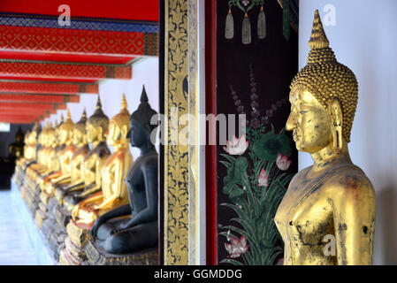 Buddha Statues in Wat Po, Bangkok, Thailand - Stock Photo