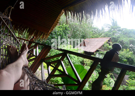 Relaxing in a hammock in Ban Mae Hat, West coast, island of Tao, Golf of Thailand, Thailand - Stock Photo