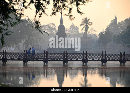 Wat Tranpang Ngoen and reflection in a lake, Old-Sukhothai, Thailand - Stock Photo
