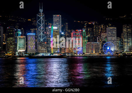 Hong Kong, Hong Kong SAR, China. 25th July, 2016. The lights of the Hong Kong city skyline reflect in the water - Stock Photo