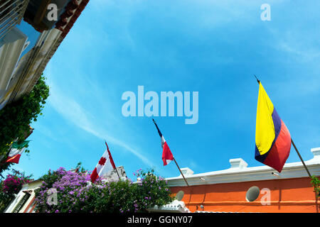 Rows of flags on colonial buildings in Cartagena, Colombia - Stock Photo