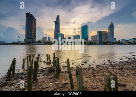 Business and Administrative Center of Ho Chi Minh city on Saigon riverbank in sunset (HDR), Saigon, Vietnam - Stock Photo