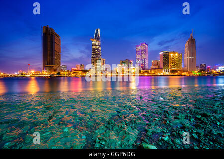 Night view of Business and Administrative Center of Ho Chi Minh city on Saigon riverbank in twilight, Saigon, Vietnam - Stock Photo