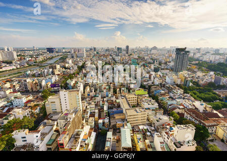 Ho Chi Minh city (or Saigon) skyline with colorful house in sunset, Vietnam. - Stock Photo