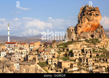Town Ortahisar in Cappadocia with the extinct volcano Erciyes in the background. - Stock Photo