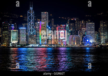 Hong Kong,Hong Kong SAR,China.25th July 2016.Hong Kong skyline lights reflect in the water.© Jayne Russell/Alamy - Stock Photo